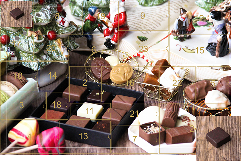 Picture of a mix of porcelain figurines representing a Christmas scenery, next to a Christmas porcelain tree and chocolates and nice treats. All divided in 24 advent calendar sections, with the first section, being a picture of a square dark chocolate bite with red sprinkles on top on a dark wood table, as if the calendar has been opened.