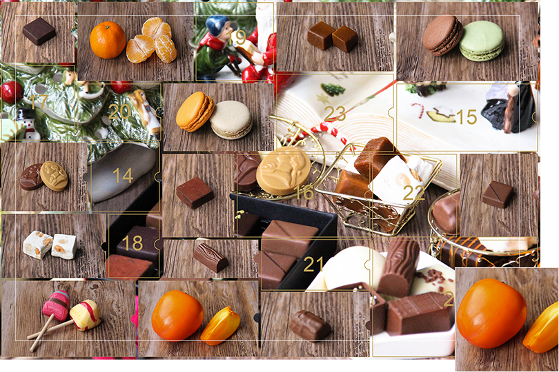 Picture of a mix of porcelain figurines representing a Christmas scenery, next to a Christmas porcelain tree and chocolates and nice treats. All divided in 24 advent calendar sections that are being uncovered each day. Section 13 is a picture of a persimmon next to a persimmon slice, on a dark wood table.