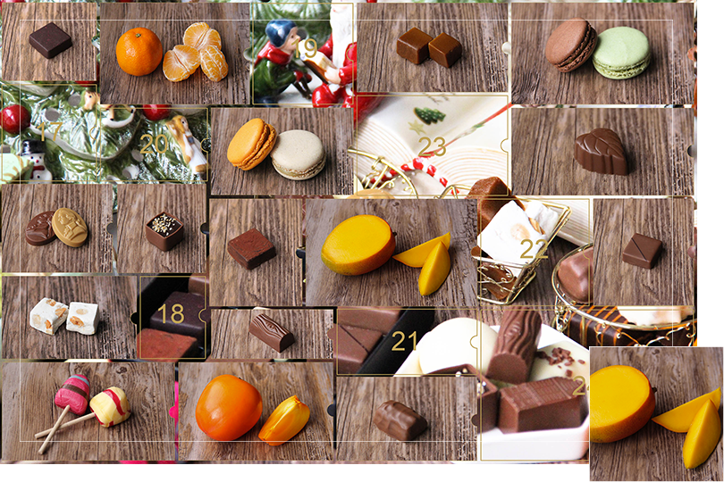 Picture of a mix of porcelain figurines representing a Christmas scenery, next to a Christmas porcelain tree and chocolates and nice treats. All divided in 24 advent calendar sections that are being uncovered each day. Section 16 is a picture of a mango cut in half next to two slices of mango on a dark wood table.