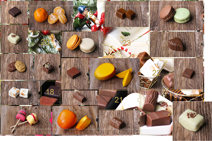 Picture of a mix of porcelain figurines representing a Christmas scenery, next to a Christmas porcelain tree and chocolates and nice treats. All divided in 24 advent calendar sections that are being uncovered each day. Section 17 is a picture of a rectangular shape white chocolate bite with small bits of brown chocolate on top, on a dark wood table.