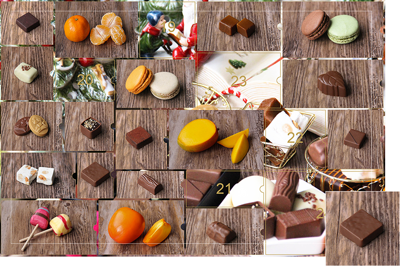 Picture of a mix of porcelain figurines representing a Christmas scenery, next to a Christmas porcelain tree and chocolates and nice treats. All divided in 24 advent calendar sections that are being uncovered each day. Section 18 is a picture of a square shape brown chocolate bite on a dark wood table.