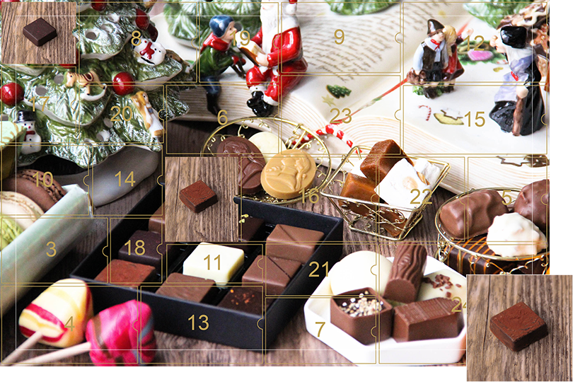 Picture of a mix of porcelain figurines representing a Christmas scenery, next to a Christmas porcelain tree and chocolates and nice treats. All divided in 24 advent calendar sections, with the second section, being a picture of a square dark chocolate bite with chocolate powder sprinkled on top on a dark wood table, as if the calendar has been opened.