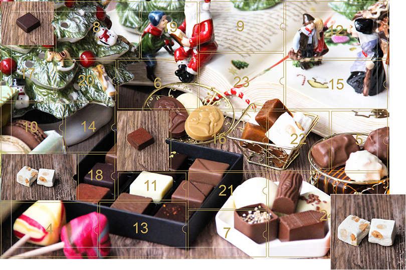 Picture of a mix of porcelain figurines representing a Christmas scenery, next to a Christmas porcelain tree and chocolates and nice treats. All divided in 24 advent calendar sections, with the third section, being a picture of two squared white nougat bites with nuts inside on a dark wood table, as if the calendar has been opened.