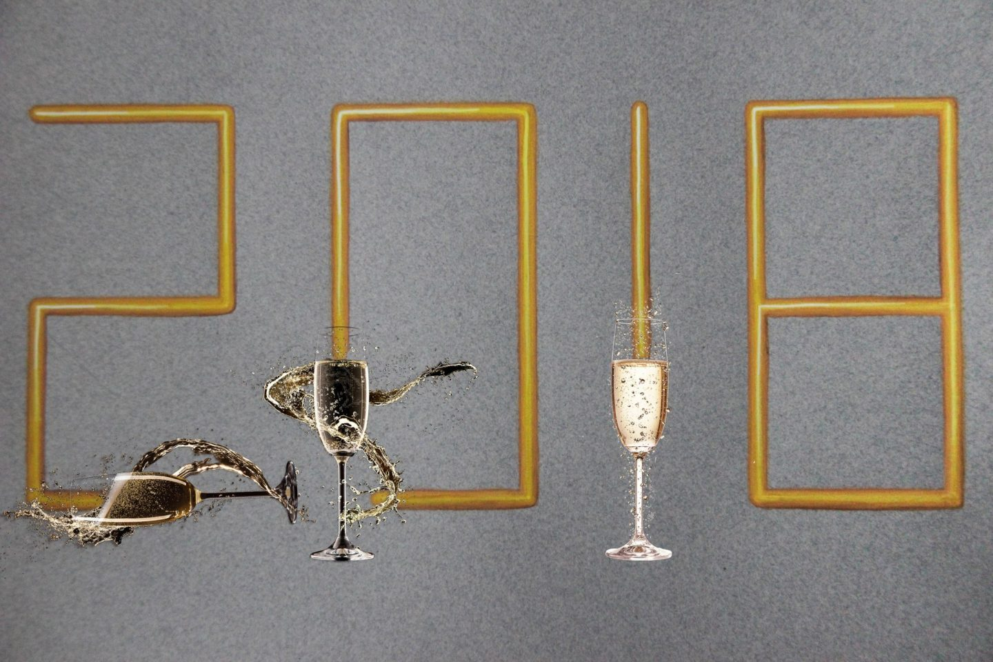 """Picture of a few glasses of champagne acting as the base of """"2018"""" written as a painting of golden tubes"""