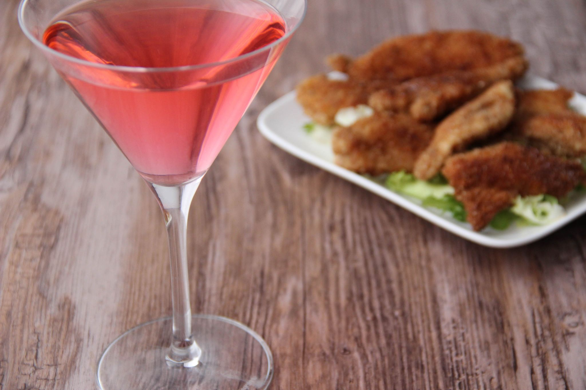 Martini litchi cocktail and chicken nuggets