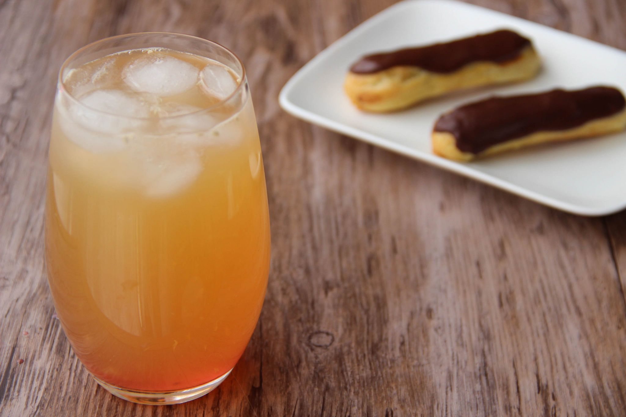 Tequila sunset cocktail and chocolate eclairs