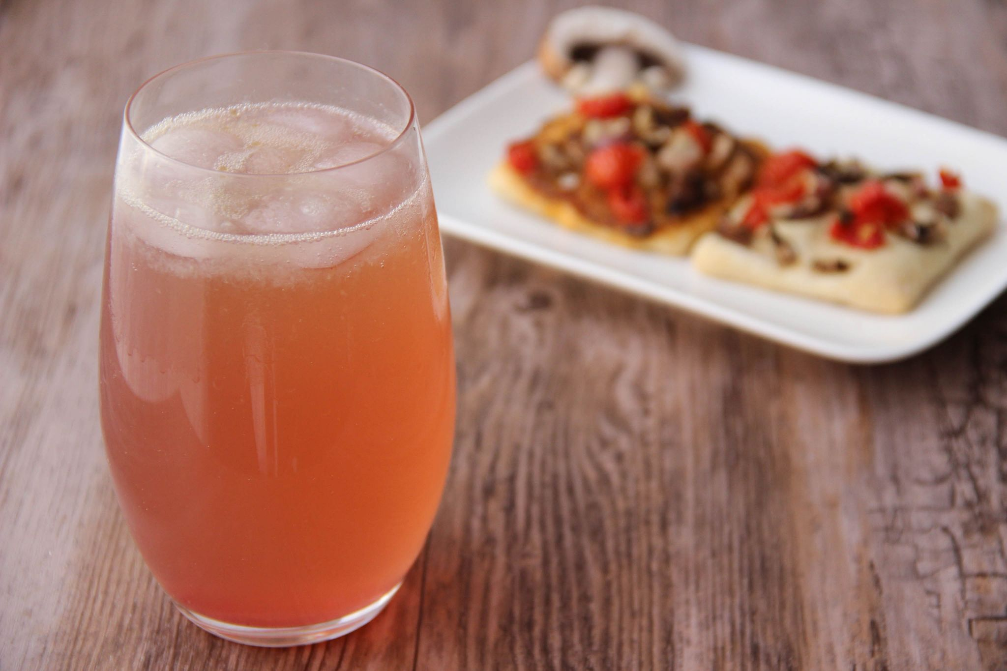 Shirley temple cocktail and mini pizzas