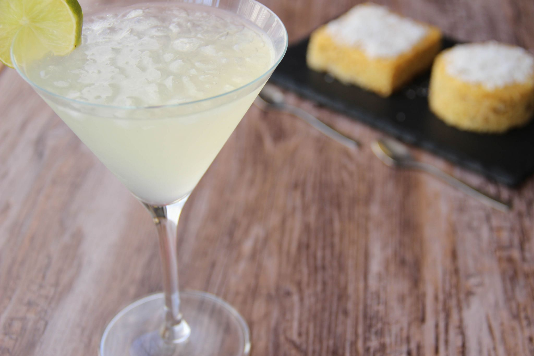 Frozen margarita cocktail and pineapple coco cake