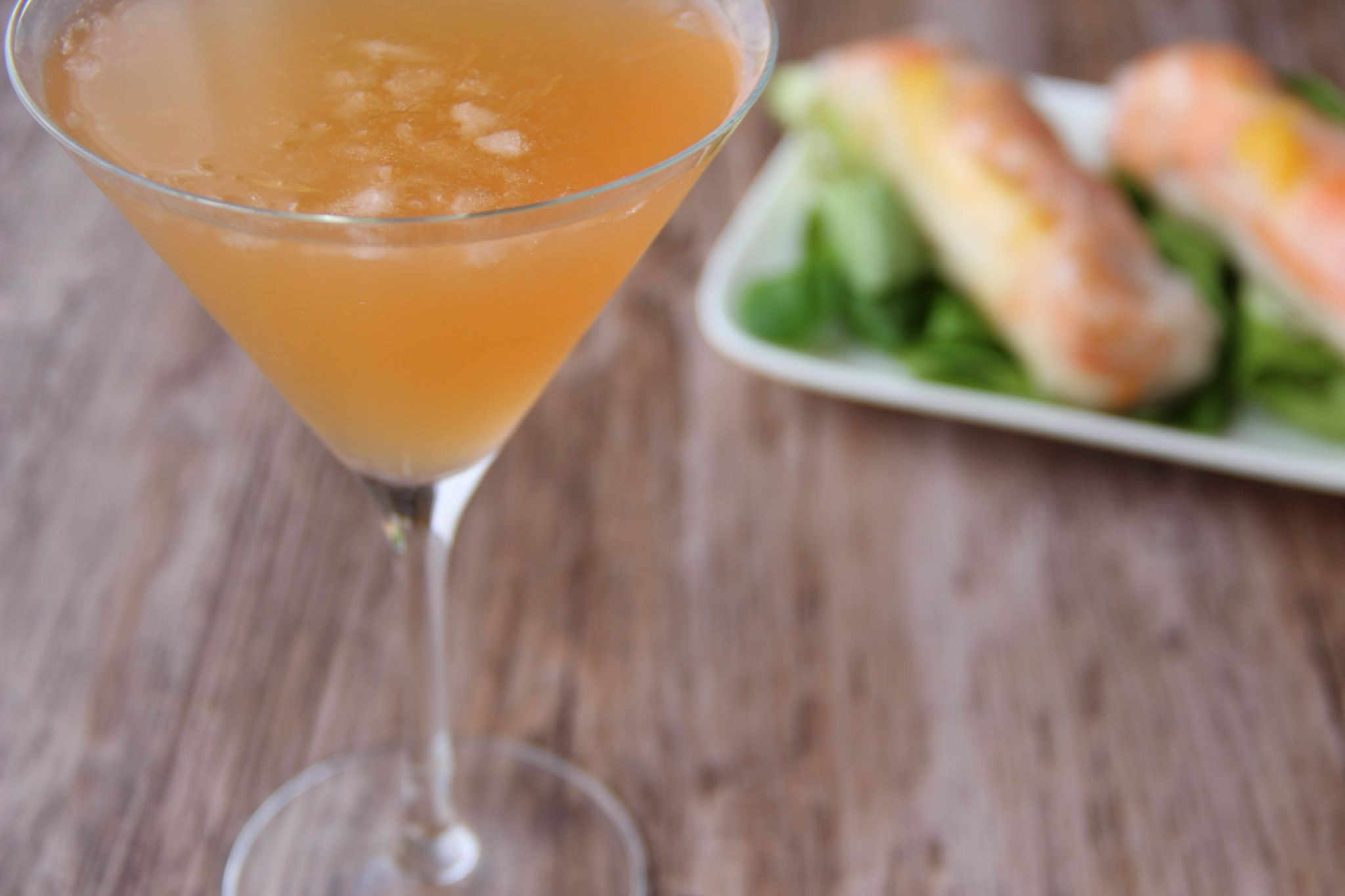Tango martini cocktail and mango shrimps springrolls