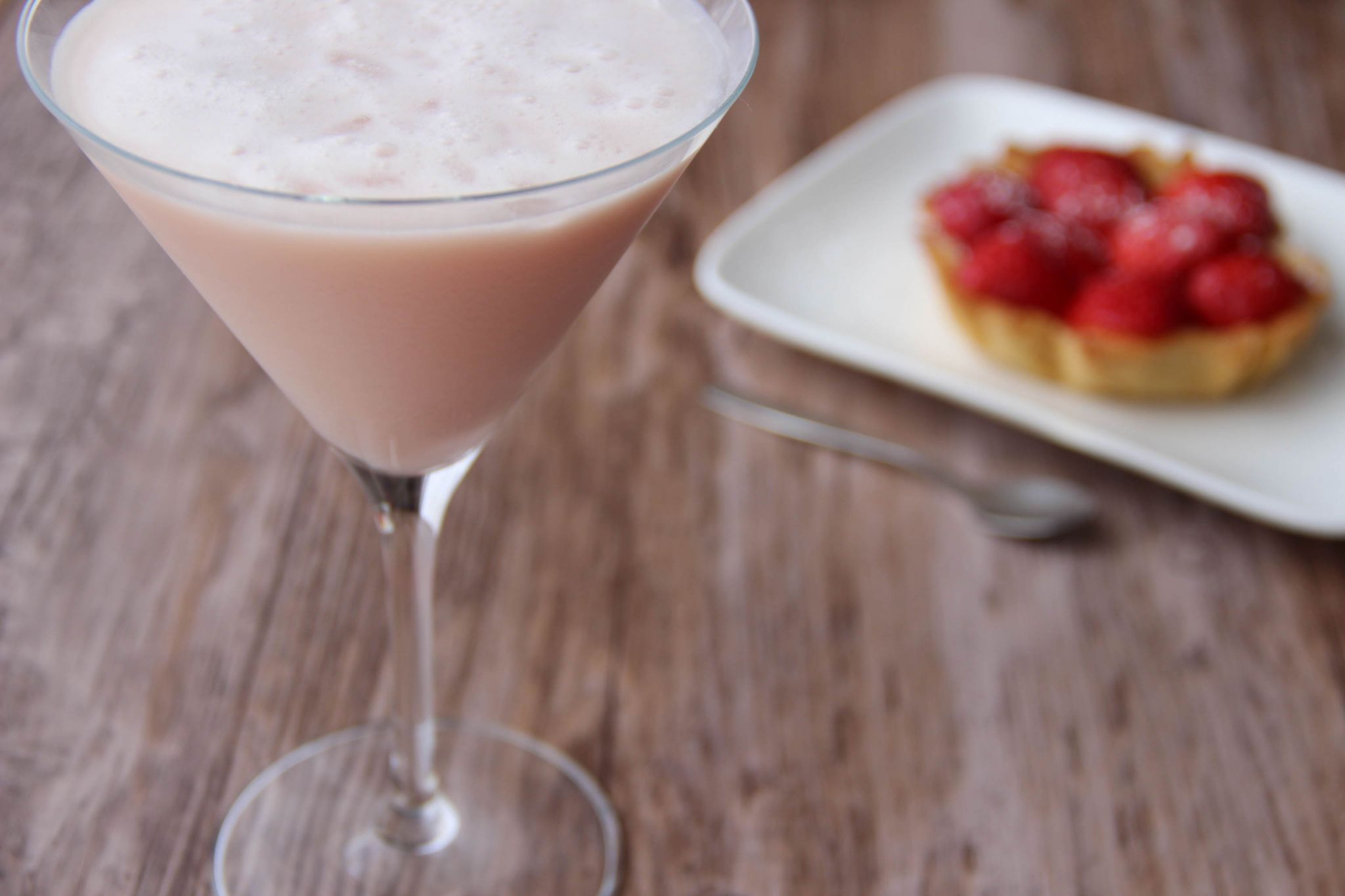 Blush martini cocktail and strawberry tart
