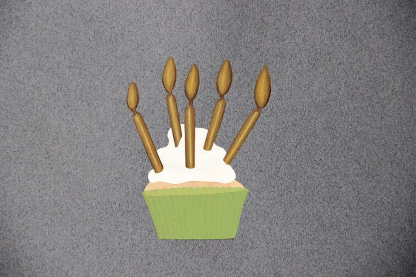 Painting of 5 gold candles on top of a drawing of a cupcake with a green fold topped with white whipped cream.